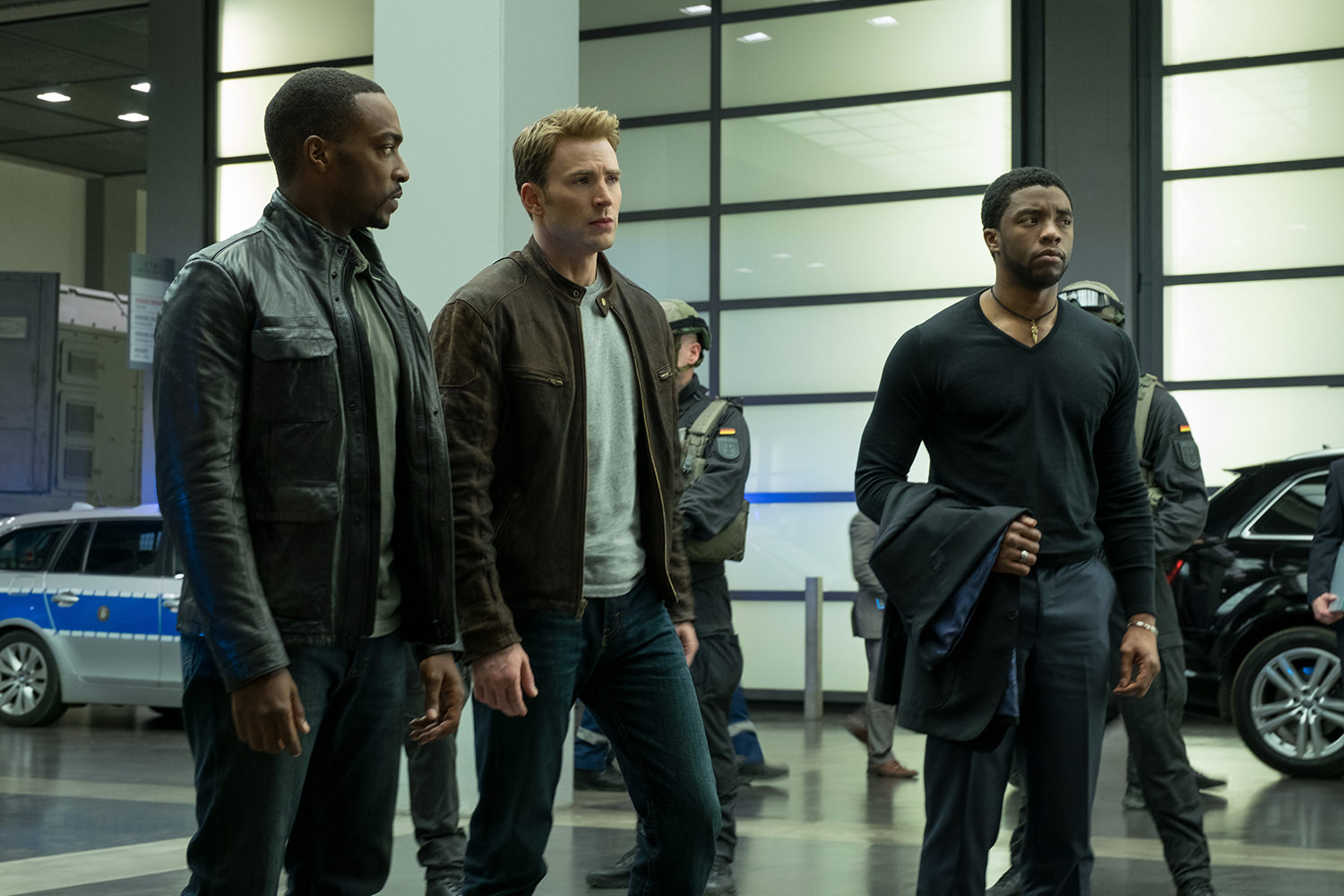 Marvel's Captain America: Civil War..L to R: Falcon/Sam Wilson (Anthony Mackie), Captain America/Steve Rogers (Chris Evans), and T'Challa/Black Panther (Chadwick Boseman)..Photo Credit: Zade Rosenthal..© Marvel 2016