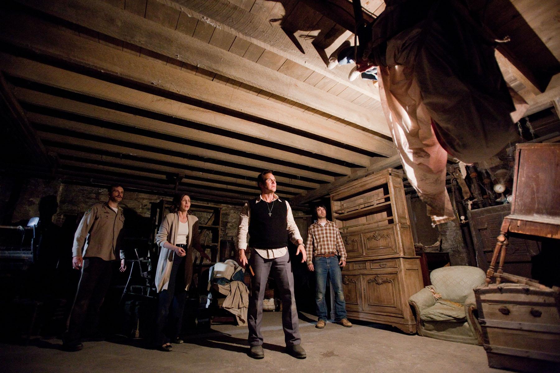 """INT PERRON HOUSE - CELLAR Carolyn flips upside down and shoots up to the ceiling John Brotherton (Brad), Vera Farmiga (Lorraine), Patrick Wilson (Ed), Ron Livingston (Roger)"""
